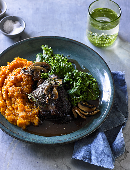 Slow cooked grass-fed beef cheeks served with sweet potato mash, mushrooms, kale & a red wine jus.