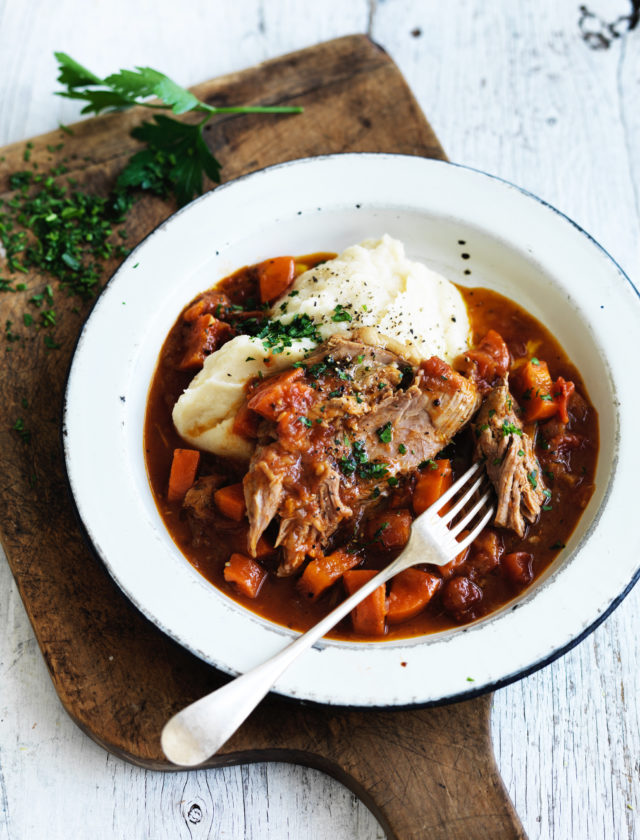 Grass-fed lamb shoulder marinated with aromatic spices & slowly cooked for 12 hours in a rich tomato & onion sauce. Served with a creamy cauliflower & parsnip mash.